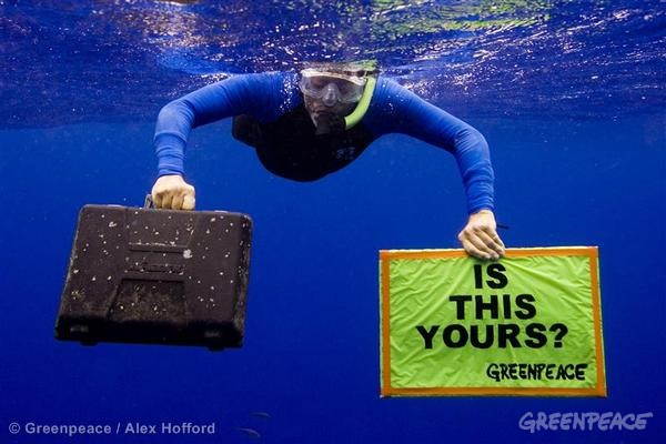 A Greenpeace activist displays an empty 'Wagner' toolbox found awash in the high seas of the Central North Pacific Ocean. This is part of the Ocean Defenders Campaign in which the Greenpeace ship Esperanza MV sails to the Pacific Ocean, sometimes referred to as the North Pacific garbage patch, to document the threat that plastic poses to environment and sea life.