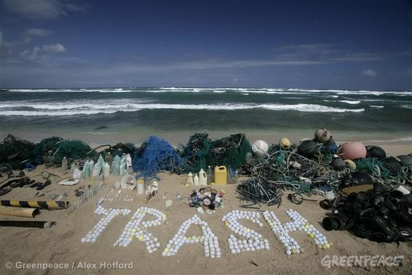 Plastic is displayed on a beach and the word Trash is spelt out from golf balls. The wide variety of items shown in this image highlight the diverse range of sources from which the plastics in our oceans originate. This is part of the Ocean Defenders Campaign in which the Greenpeace ship Esperanza MV sails to the Pacific Ocean, sometimes referred to as the North Pacific garbage patch, to document the threat that plastic poses to the environment and sea life.