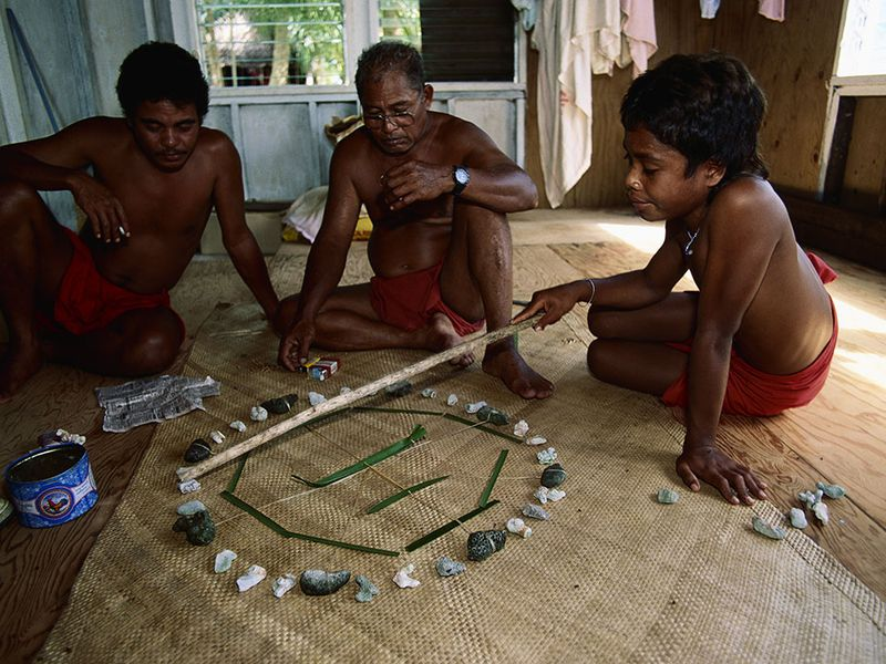 Master navigator Mau Piailug teaches navigation to his son and grandson with the help of a star compass. (Anders Ryman, Satawal, Federated States of Micronesia © Anders Ryman/Corbis) Read more: http://www.smithsonianmag.com/smithsonian-institution/how-voyage-kon-tiki-misled-world-about-navigating-pacific-180952478/#iS1bPZzYgcehzVJ6.99 Give the gift of Smithsonian magazine for only $12! http://bit.ly/1cGUiGv Follow us: @SmithsonianMag on Twitter