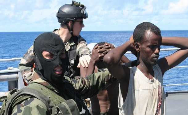 "A file picture taken on May 3, 2009 shows French soldiers guard suspected Somali pirates on board the French warship ""Le Nivose"", after their capture, as part of EU's Atalante anti-piracy naval mission. Attacks on the world's seas are soaring as armed and dangerous pirates become increasingly emboldened, seizing more ships than before and taking even bigger risks, an international body said on July 14, 2011. AFP PHOTO / PIERRE VERDY (Photo credit should read PIERRE VERDY/AFP/Getty Images)"